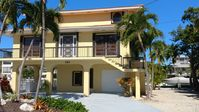 Luxury Islamorada 3-story home 100 foot deep water dock huge pool