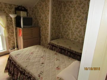 Bedroom upstairs with two single beds that can be made into a king bed.