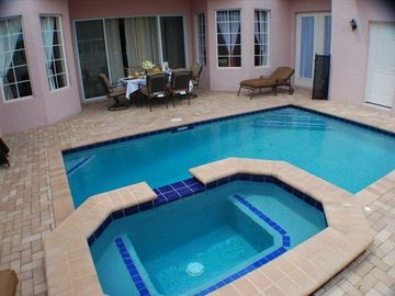 Secluded Sunny Pool and Spa with covered outdoor dining !