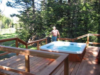 Hot Spring Spa on deck overlooking Forest Service meadow