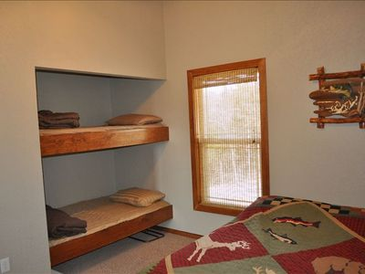 Upper Level Bedroom #4 with full size bed, bunk beds and flat screen TV