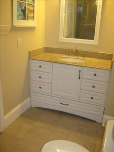 Full bath on 3rd floor with jacuzzi tub/marble shower. Granite counters.