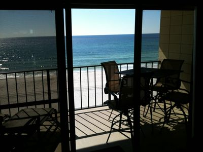 VIEW OF THE BEACH, 2 LOUNGERS, RAISED TABLE WITH 4 SWIVEL CHAIRS