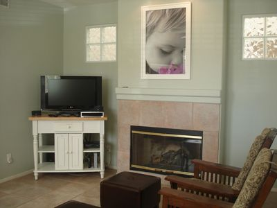 Family Room with one of 3 fireplaces within the house