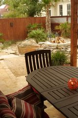 San Antonio bungalow photo - Outdoor covered patio (including ceiling fan and light) and table for 6 people.