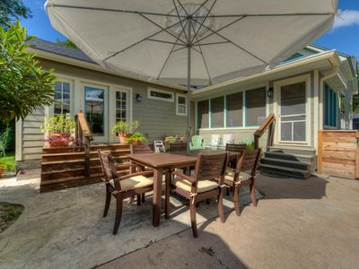 Courtyard has a teak Dining Set with umbrella plus loungers
