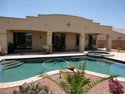 Private, heated pool & spa with an extended covered patio