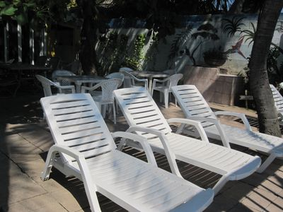 Patio area for lounging in the sun w/ perfect views of the ocean. BBQ pit area.