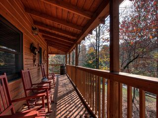 Pigeon Forge cabin photo - Side Porch With Rocking Chairs Overlooking Large Leveled Yard.