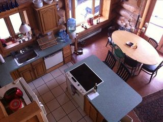 aerial view of kitchen/ dining area from loft stairs