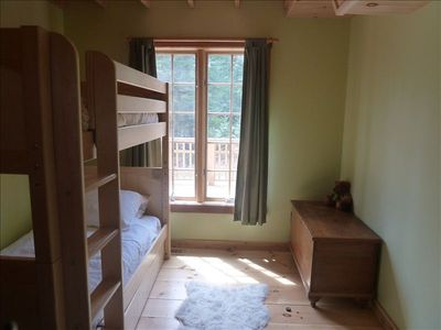 Children's room with bunk beds and trundle