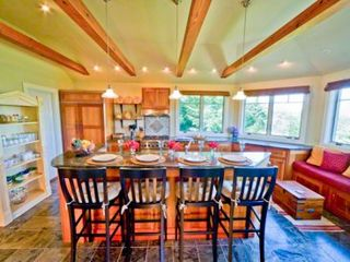 Gayhead - Aquinnah house photo - Kitchen Is Designed For Entertaining With Center Island Seating, Large Built-in Window Seating, Water Views & French Doors That Open To Screened Porch