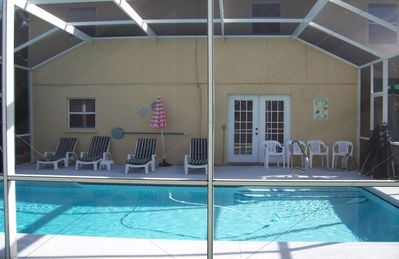 Large heated pool and sun patio at rear of house