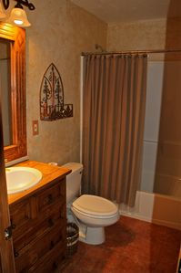 Guest Bath utilizes antique cabinets and mirror