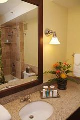 Upgraded bathroom with marble counter and ceramic tile flooring - Lihue hotel vacation rental photo