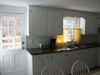 Yarmouth townhome photo - Kitchen, back door to deck with hot tub