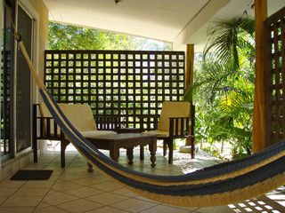 Tamarindo studio photo - The 'Blue' cabina patio and hammock.