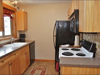 Kitchen with new tile floors, backsplash, appliances