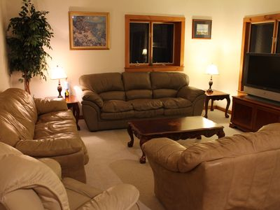 Lower floor den area. Two leather couches, a leather love seat, recliner, and TV
