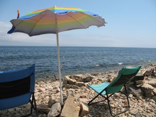 Prospect Harbor cottage photo - Relax under the beach umbrella, read a book, or write out your postcards.