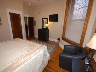 Capitol Hill apartment photo - Comfortable main bedroom, queen bed, TV with cable
