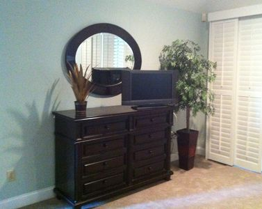 Master Bedroom has walk in his & her's closets, extra dresser & flat screen TV