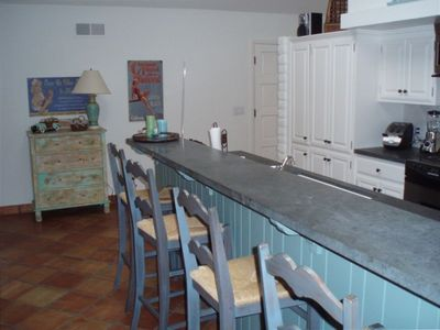 Fully stocked kitchen with barstools