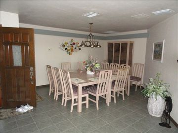 Front door opens to dining area with tables & 12 chairs. Great for large groups!