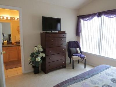 Upstairs Queen bedroom with LCD TV and access to shared full washroom.