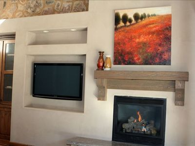 Big screen T.V and super warm, cozy, fire place. DVD player and surround sound.