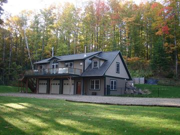 Traverse City house rental - This beautiful home has a fire pit with lots of wood, hammocks and lounge chairs