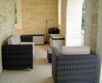 The villa terrace with comfortable seating.