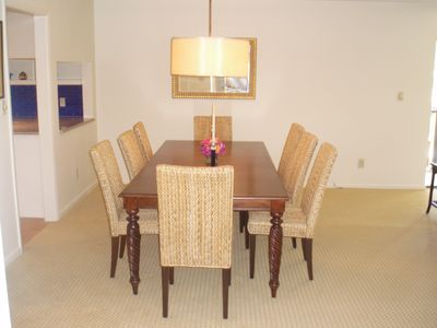dining area, with 8 chairs and room for 4 more when add leaf in closet