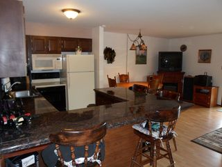 Dillon condo photo - Full kitchen with granite counter tops, dining area, and counter height seating.