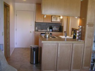 full kitchen includes utensils, cookware, range oven, toaster, microwave, fridge