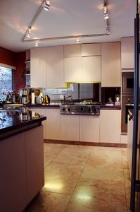 Spacious kitchen featuring granite counter tops and stainless steel appliances.