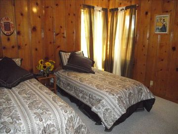 Downstairs guest room; twin beds convert into a king bed