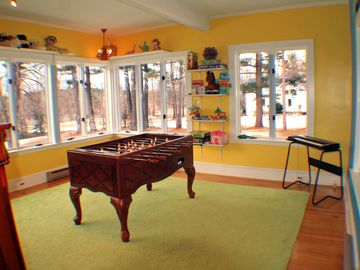 Game room for the whole family with wii, foosball, toys, keyboard, games, etc
