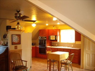 spacious kitchen, dining area and pantry