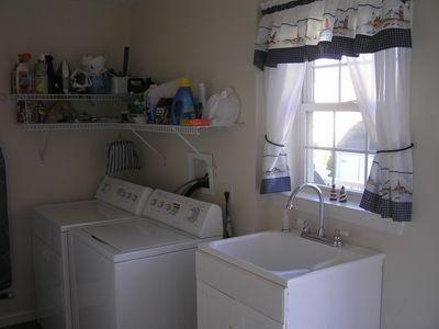 Laundry Room with full washer and dryer