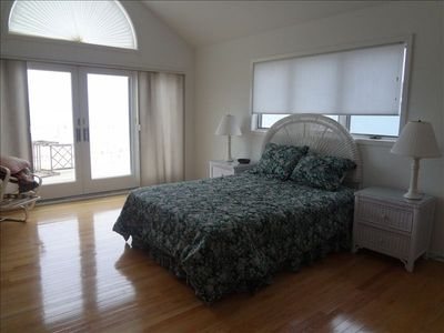 2nd floor Master bedroom #1 with ocean front deck access and private bathroom.