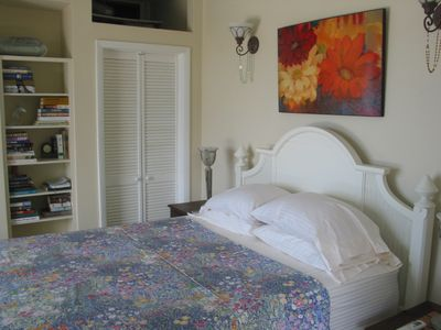 Off the pool deck is the main level bedroom suite which is air conditioned