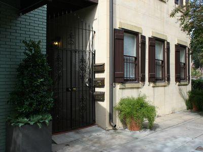 Street view of townhouse and entry gate