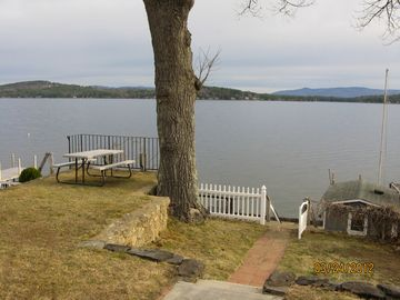 View of lake from cottage steps. Early morning coffee on the table is awesome.
