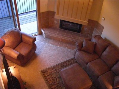 Beautifully Tiled Fireplace, Sofa, Love seat..