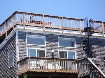 Provincetown condo rental - Unit D is our 3rd floor condo, perched overlooking Cape Cod Bay w/ pvt roof deck