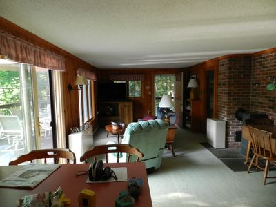Living Room w internet FSHDTV, slider to lake front deck, and side hc entrance.