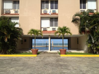 Entrance to the building with a view of the ocean behind it.