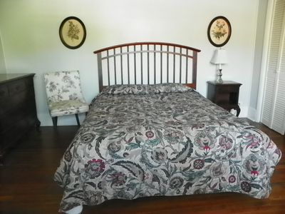 Spacious master bedroom has queen bed and one single bed.