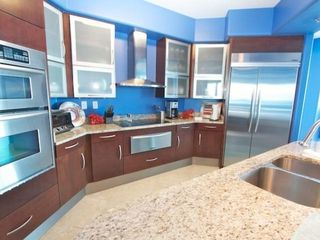 Orange Beach condo photo - Fully equipped kitchen with granite countertops